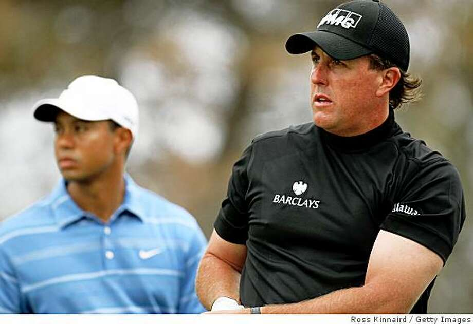 SAN DIEGO - JUNE 12:  Tiger Woods watches after Phil Mickelson hit his tee shot on the second hole during the first round of the 108th U.S. Open at the Torrey Pines Golf Course (South Course) on June 12, 2008 in San Diego, California.  (Photo by Ross Kinnaird/Getty Images) Photo: Ross Kinnaird, Getty Images
