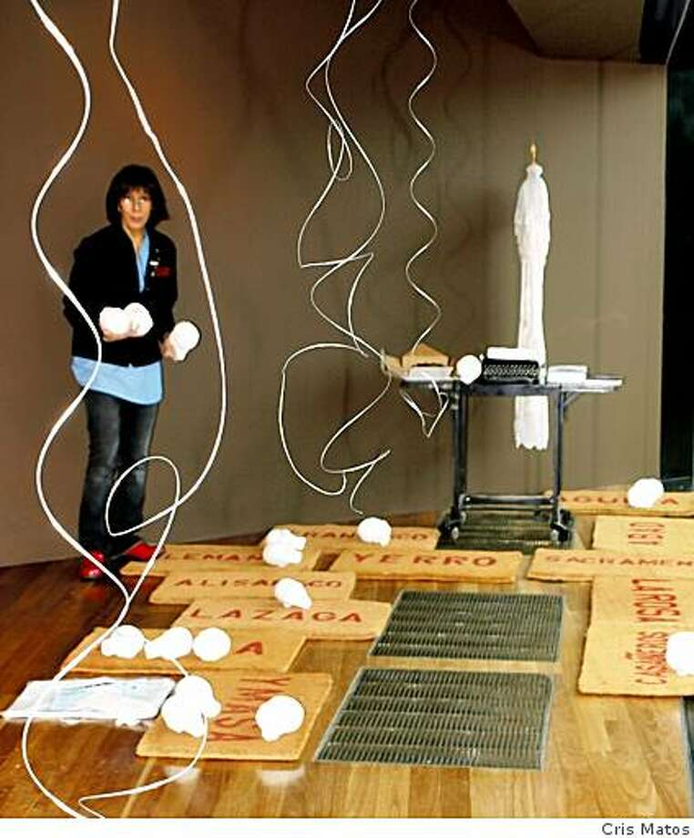 "Asian American Women Artists Association member Terry Acebo Davis works on her ""place"" in the Kimball Education Gallery at the de Young Museum. See her finished project at the closing reception party on Friday Jan. 30. Photo: Cris Matos"
