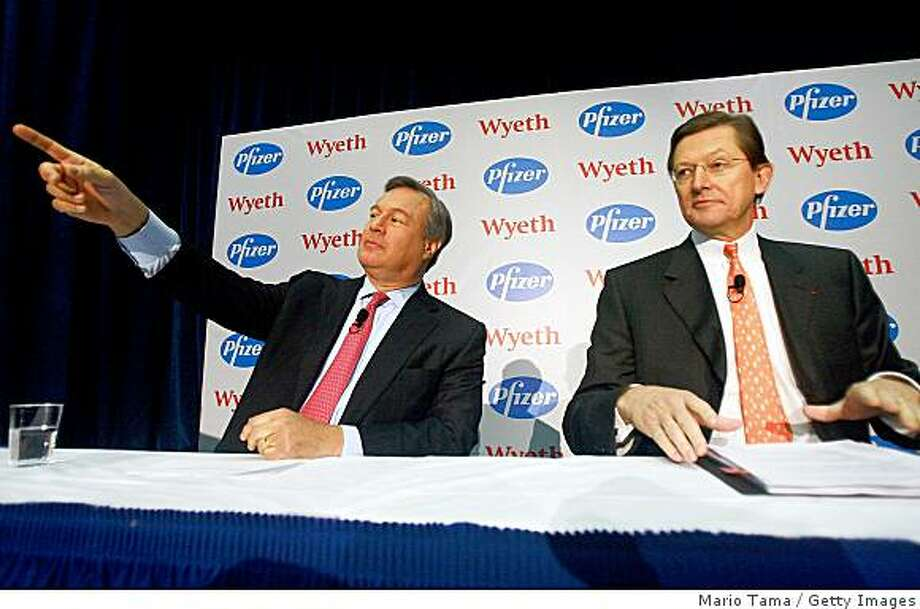 NEW YORK - JANUARY 26:  Jeffrey B. Kindler, CEO of Pfizer (L) and Bernard Poussot, CEO of Wyeth, appear at a news conference discussing the planned merger of their companies January 26, 2009 in New York City. Pfizer plans to acquire Wyeth for $68 billion, creating the world's largest biopharmaceutical company.  (Photo by Mario Tama/Getty Images) Photo: Mario Tama, Getty Images