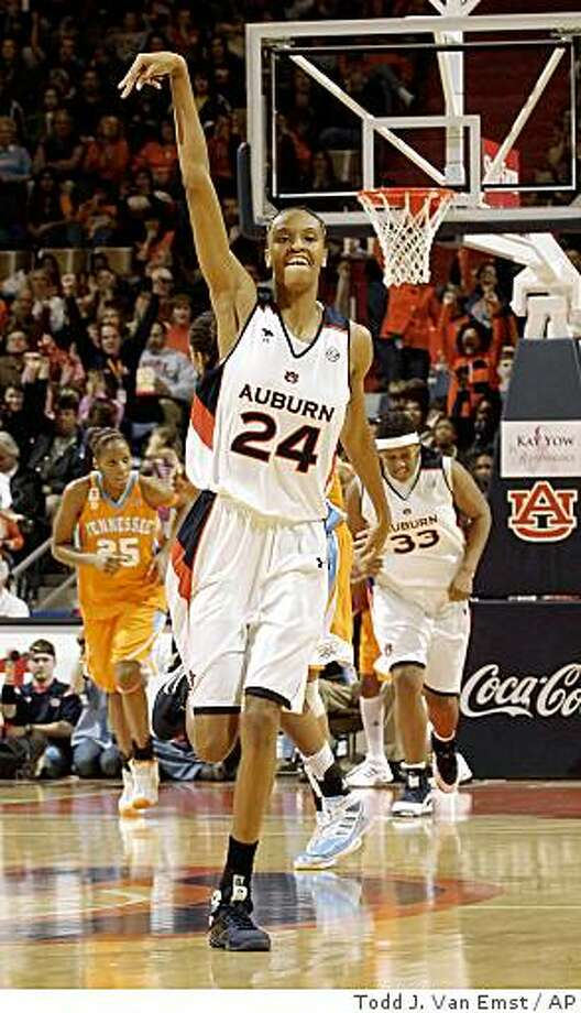 Auburn's DeWanna Bonner celebrates after making a 3-point basket against Tennessee in the second half of an NCAA college basketball game Sunday, Jan. 25, 2009, in Auburn, Ala. Auburn won 82-68. (AP Photo/Todd J. Van Emst) Photo: Todd J. Van Emst, AP