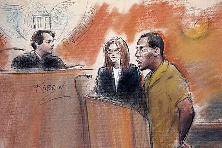 In this artist rendering, Umar Farouk Abdulmutallab, right, stands with his attorney Miriam Siefer, center, before U.S. District Judge Nancy Edmunds in federal court in Detroit, Monday, Sept. 13, 2010. Abdulmutallab, the Nigerian man charged with trying to blow up an Amsterdam-to-Detroit flight on Christmas fired his lawyers Monday and suggested he wants to plead guilty to some charges. Photo: Carole Kabrin, AP