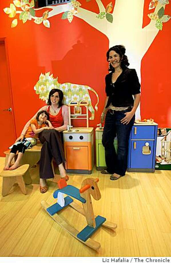 Owners Erin Carter (left) with four year old daughter Ruby Carter,  and Keri Levy (right) at Kid Dynamo, an eco-friendly children's boutique in Berkeley, Calif., on Tuesday, January 13, 2009 Photo: Liz Hafalia, The Chronicle