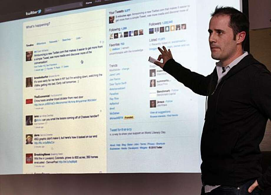 Twitter CEO Evan Williams is seen against a screen as he shows off the newly revamped Twitter website on Tuesday September 14, 2010 at Twitter headquarters in San Francisco, California. Twitter launched a new version of the popular social media site in hopes it will be more user friendly Photo: Lance Iversen, The Chronicle