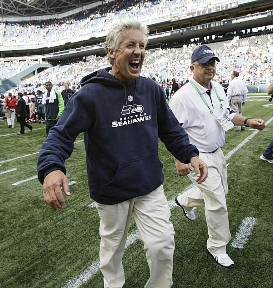 Seattle Seahawks coach Pete Carroll reacts as he moves to greet Seahawks CEO Tod Leiweke after the Seahawks beat the San Francisco 49ers 31-6 in an NFL football game, Sunday, Sept. 12, 2010, in Seattle. Photo: Ted S. Warren, AP