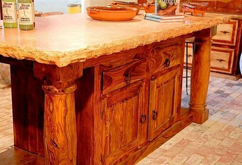 Salsa Trading Company's custom islands are made out of reclaimed rosewood.  The Baker's Island has four deep drawers for storage and a 3-inch thick travertine top. Photo: John Costill
