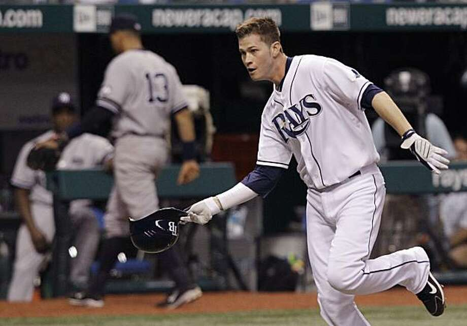 Tampa Bay Rays' Reid Brignac flings his helmet while rounding the bases after hitting an 11th-inning walkoff home run off New York Yankees relief pitcher Sergio Mitre during a baseball game Monday, Sept. 13, 2010, in St. Petersburg, Fla. New York Yankeesthird baseman Alex Rodriguez (13) leaves the field. Photo: Chris O'Meara, AP