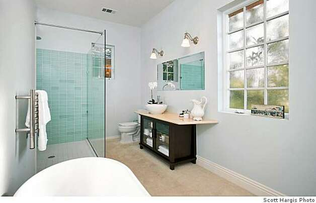 Master Bath at 65 Southampton Ave., a new house on the market for $1.98 million in North Berkeley. Owner/builder claims it's built so robustly it will withstand a major earthquake and that it's so energy efficient the electric meter will run backwards. Photo: Scott Hargis Scott Hargis, Scott Hargis Photo