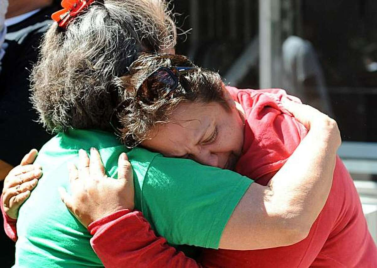 Antonia Locon (right) is seen outside the Veterans Memorial Recreation Center in San Bruno on Friday September 7, 2010. Her family had to evacuate their home after a massive natural gas pipeline explosion Thursday night.