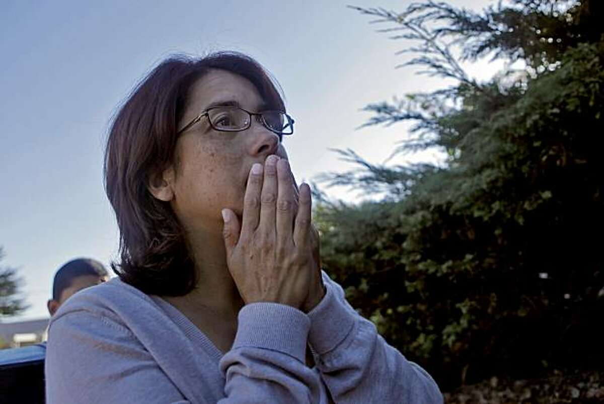 Carmen Gomez reacts after hearing she can't get to her home of road blocks, Friday Sept. 10, 2010, in San Bruno, Calif.