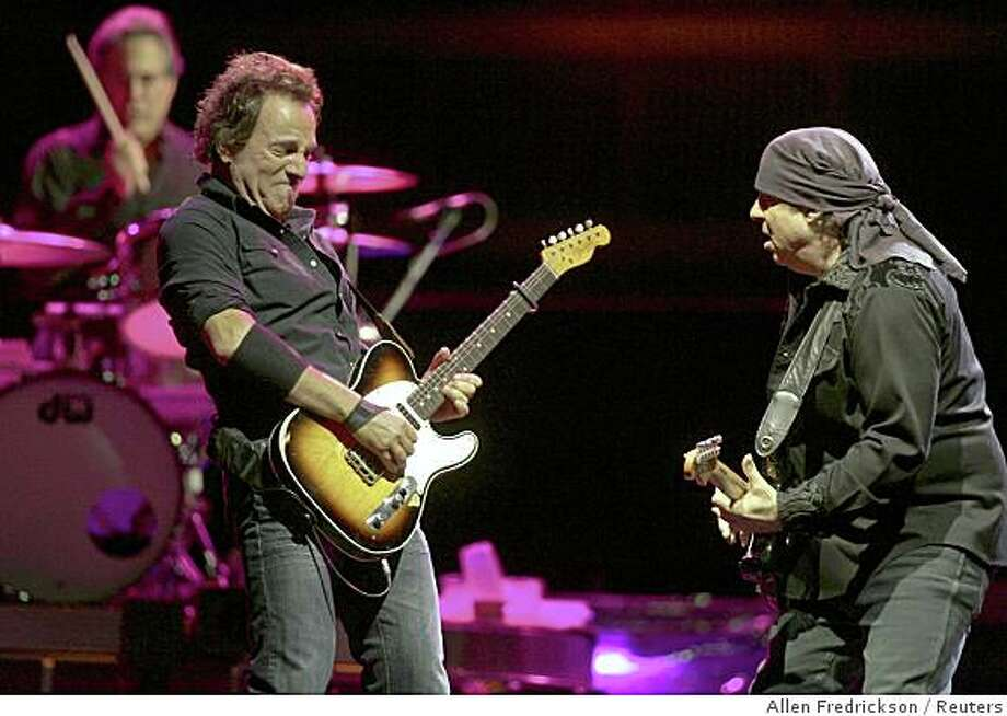 Bruce Springsteen (L) and Steve Van Zandt (R) with the E Street Band, including drummer Max Weinberg (rear), perform at Veterans Park in celebration of the 105th anniversary of Harley-Davidson motorcycles in Milwaukee, Wisconsin August 30, 2008.   ) Photo: Allen Fredrickson, Reuters