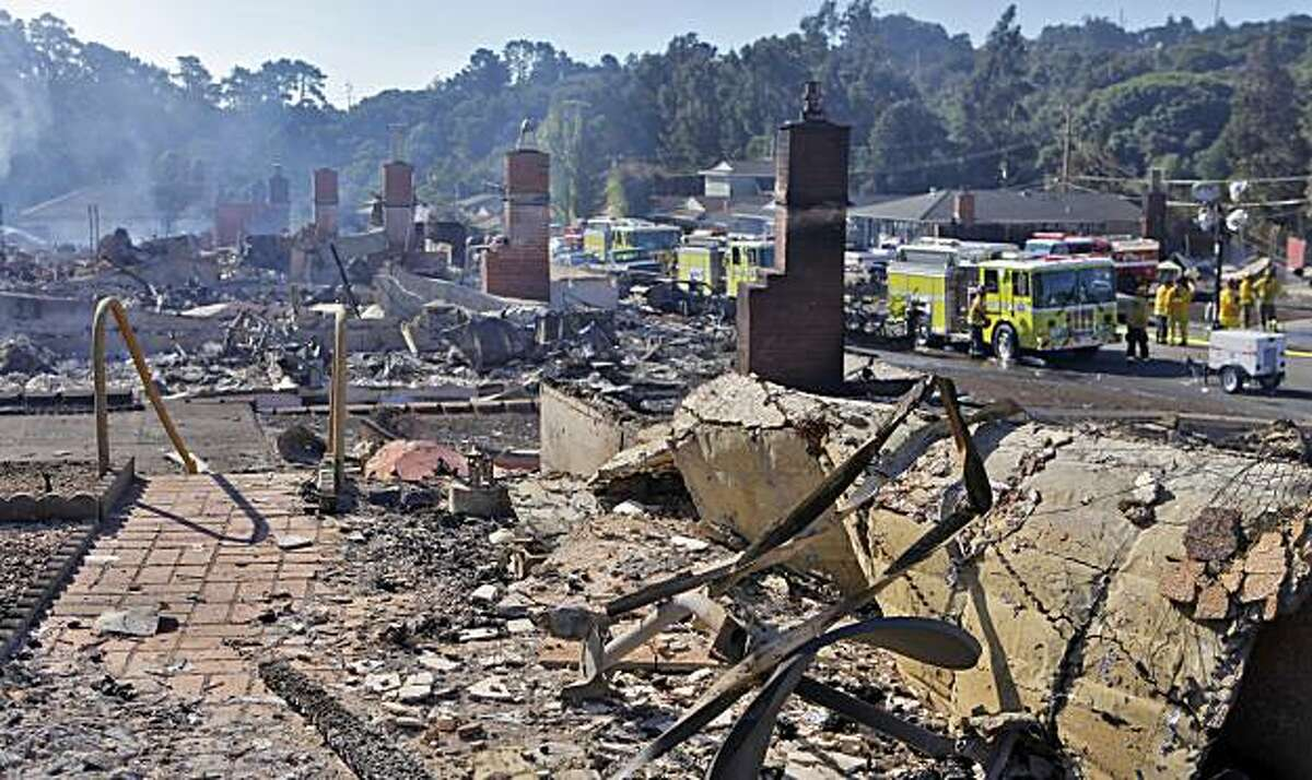 Chimneys stand without their homes, Friday Sept. 10, 2010, from the inferno that happened last night, in San Bruno, Calif.