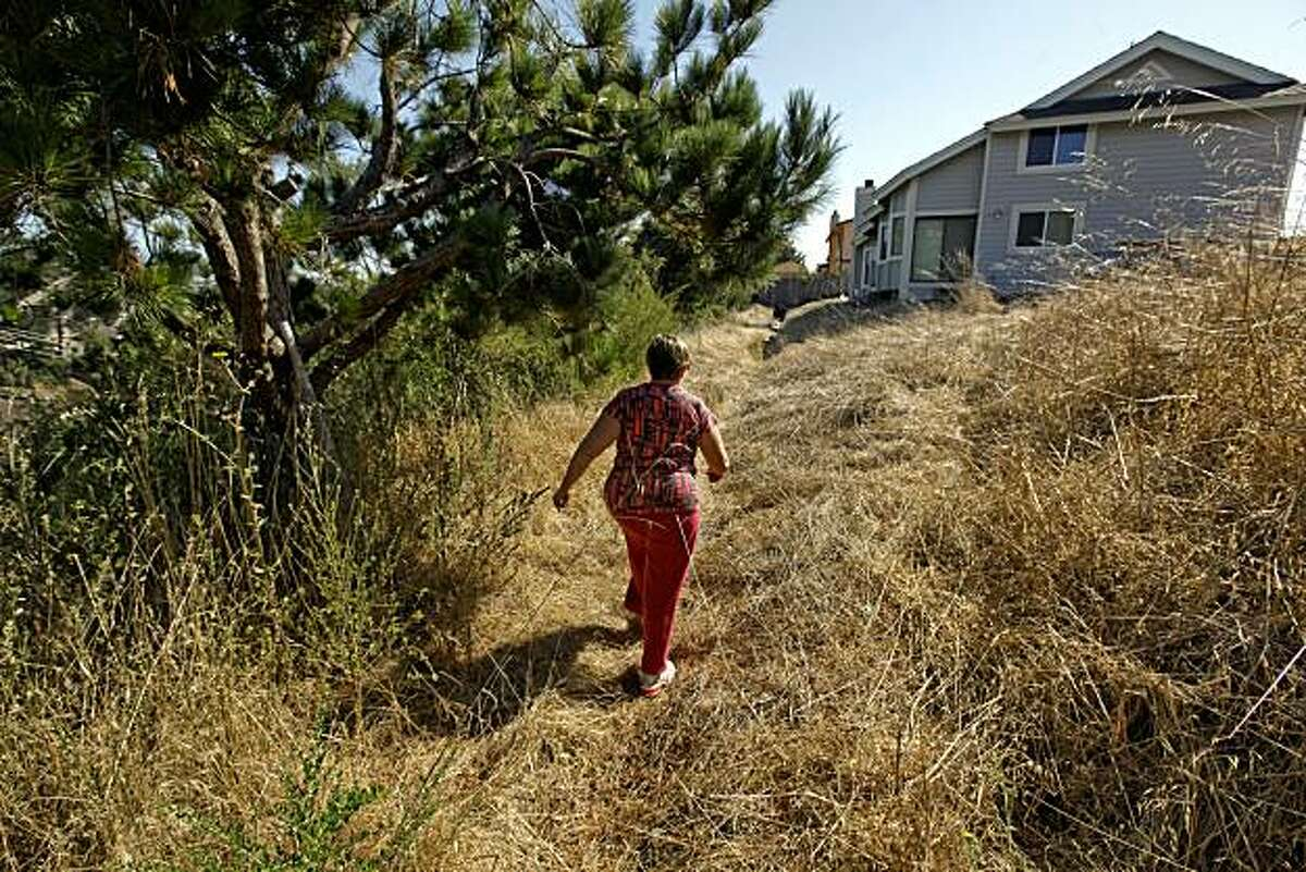 Homeowner Denise Barr, takes a back way into her neighborhood in hopes of getting a glimpse of her home, when she peered down below she saw that the fire had been stopped just a couple of doors down and her place was safe, after a hugh natural gas blast leveled a her neighborhood last night in San Bruno, Calif.