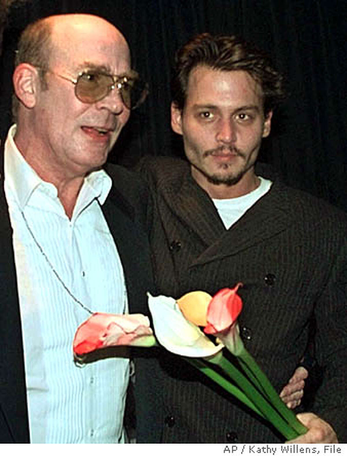 **FILE** Hunter Thompson, left, and Johnny Depp at the premier of the film adaptation of Thompson's book