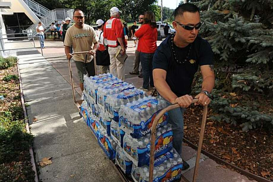 Bobby Im of the National Gaurd San Mateo brings water to the water at the Veterans Memorial Recreation Center in San Bruno on Friday September 10, 2010. Many people had to evacuate their home after a massive natural gas pipeline explosion Thursday night. Photo: Susana Bates, Special To The Chronicle