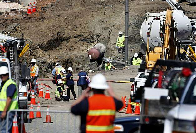 Work crews on Glenview Drive, near the plugged gas pipe (center) Sunday. Photo: Brant Ward, The Chronicle