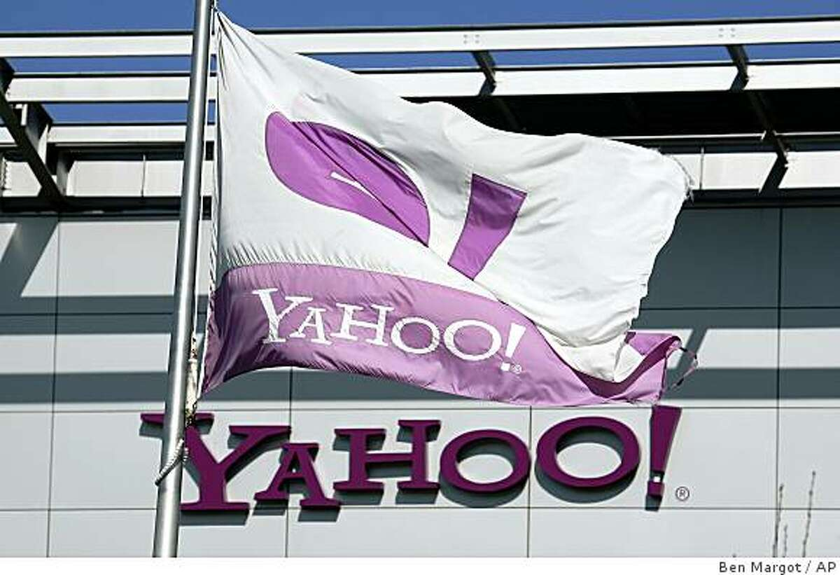 A Yahoo flag waves over company headquarters Tuesday, Jan 27, 2009, in Sunnyvale, Calif. Yahoo suffered a fourth-quarter loss of $303 million because of costs for employee layoffs and soured investments. Despite the setback, the results weren't as bad as analyst feared. (AP Photo/Ben Margot)