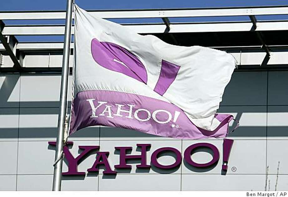 A Yahoo flag waves over company headquarters Tuesday, Jan 27, 2009, in Sunnyvale, Calif.  Yahoo suffered a fourth-quarter loss of $303 million because of costs for employee layoffs and soured investments. Despite the setback, the results weren't as bad as analyst feared. (AP Photo/Ben Margot) Photo: Ben Margot, AP