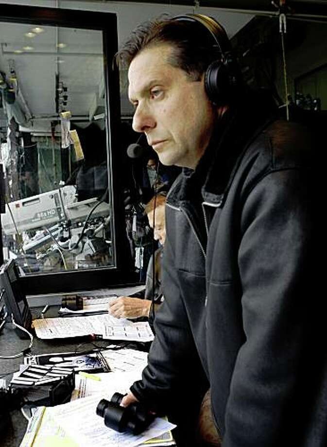 Oakland Raiders radio play-by-play announcer Greg Papa prepares for the game against the New England Patriots in Oakland, Calif., on Sunday, Dec. 14, 2008. Photo: Paul Chinn, The Chronicle