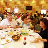 Dim Sum at Asian Pearl restaurant in Richmond, Calif., on January 19, 2009. Friends from Fairfield, Calif., having dim sum, left-right: Bob Dunn, Elizabeth Flynn and Guihzi Jai.