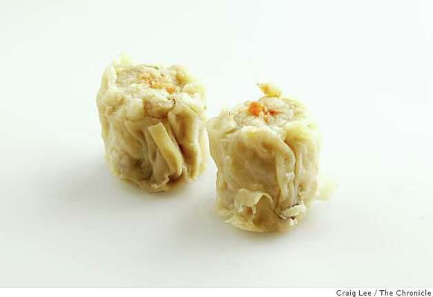 Siu maiOpen-faced dumplings are fluted at the top, traditionally filled with pork, and often mushrooms or shrimp. Usually topped with crab butter, duck egg or fish roe. Photo: Craig Lee, The Chronicle
