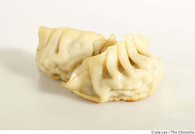 Potstickers These pan-fried crescents originated in Northern China, but have become one of the most popular items on dim sum menus, stuffed with a mixture of brothy pork and vegetables. Photo: Craig Lee, The Chronicle