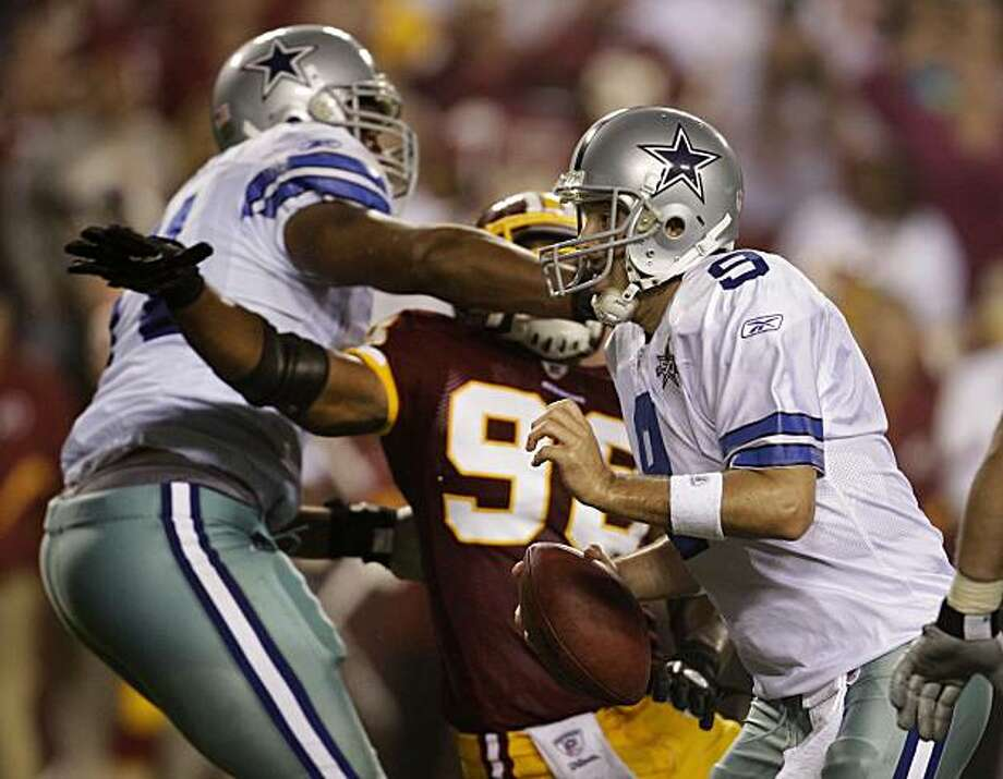 Dallas Cowboys quarterback Tony Romo (9) scrambles on the last play of the game as offensive tackle Alex Barron, left, holds Washington Redskins linebacker Brian Orakpo during an NFL football game, Sunday, Sept. 12, 2010, in Landover, Md. Offensive tackleBarron's penalty negated a Cowboys touchdown in the last seconds of the game and the Redskins won 13-7. Photo: Rob Carr, AP