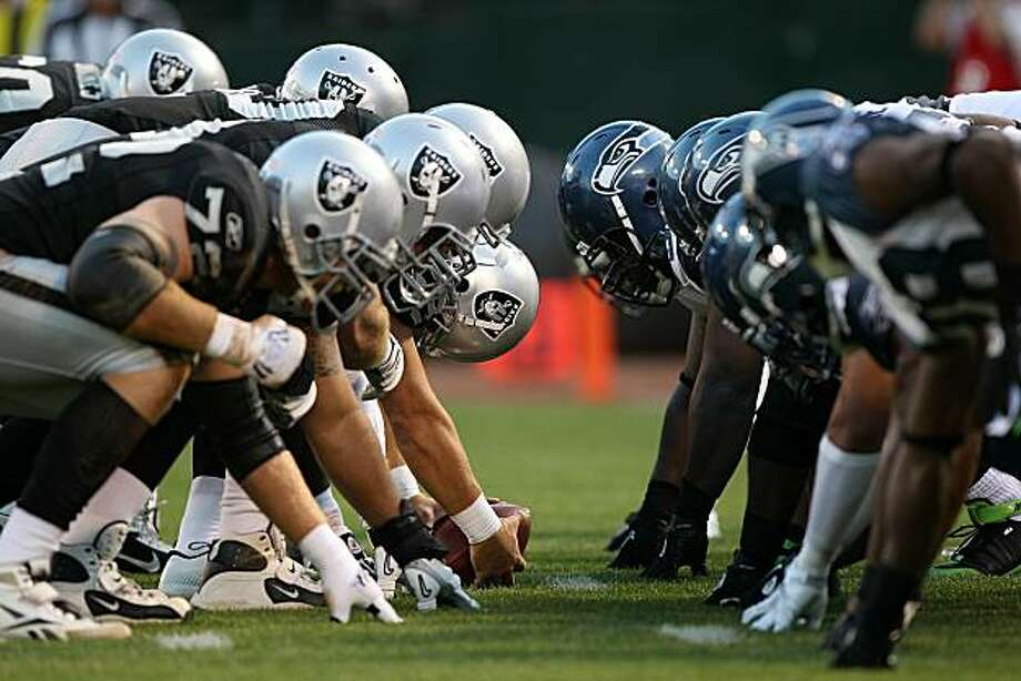 OAKLAND, CA - SEPTEMBER 2:  Members of the Seattle Seahawks line up against the Oakland Raiders during an NFL preseason game at Oakland-Alameda County Coliseum on September 2, 2010 in Oakland, California. Photo: Jed Jacobsohn, Getty Images