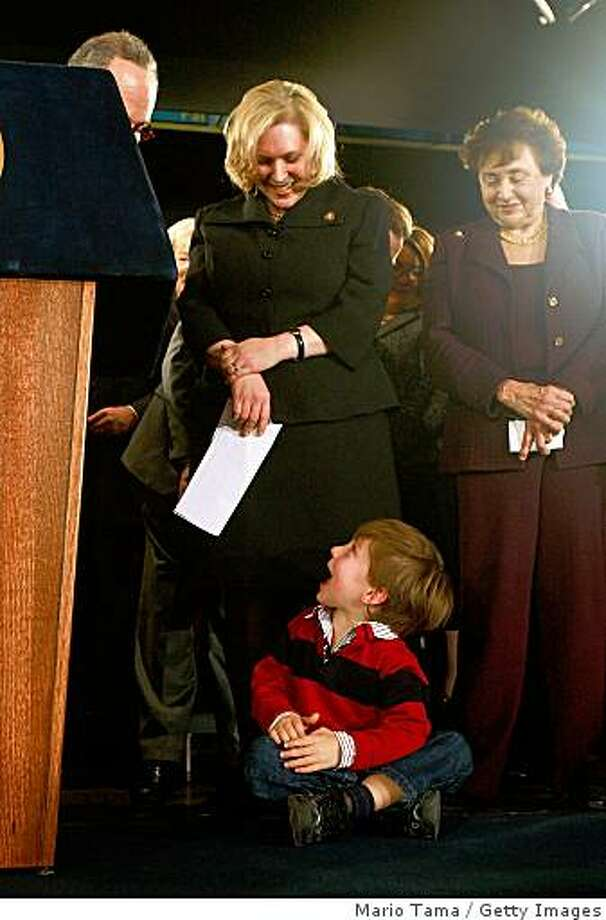 ALBANY, NEW YORK - JANUARY 23:  U.S. Rep. Kirsten Gillibrand (D-NY) (L) looks down at her son Theodore who crawled onstage as U.S. Rep. Nita Lowey (D-NY) (R) looks on during a news conference announcing her as New York Gov. David A. Paterson's choice to fill the vacant U.S. Senate seat for New York on January 23, 2009 in Albany, New York. Caroline Kennedy withdrew her name from consideration a day before the announcement of the Governor's decision for filling the seat which was left vacant by the new Secretary of State Hillary Rodham Clinton.  (Photo by Mario Tama/Getty Images) Photo: Mario Tama, Getty Images