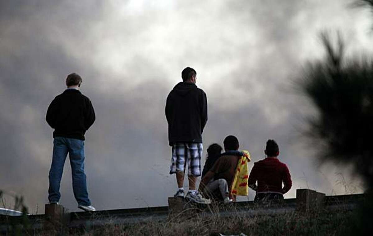 Hundreds of neighbors of a San Bruno neighborhood look on as a massive fire consumed dozens of homes Thursday, Sept. 9, 2010.
