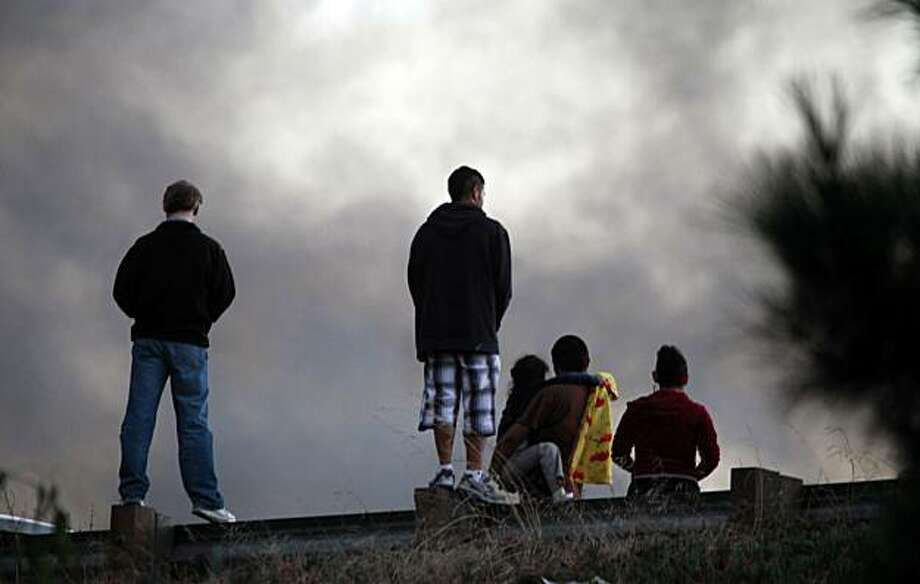 Hundreds of neighbors of a San Bruno neighborhood look on as a massive fire consumed dozens of homes Thursday, Sept. 9, 2010. Photo: Lance Iversen, The Chronicle