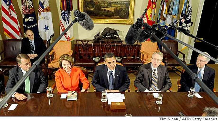 US President Barack Obama (C) makes remarks on the economy during a bi-partisian meeting with members of Congress including House Minority Leader John Boehner (L)R-OH, Speaker of the House Nancy Pelosi (2nd-L)D-CA, Senate Majority Leader Harry Reid (2nd-R)D-NV and Senate Minority Leader Mitch McConnell (R)R-KY on January 23, 2009 at the White House in Washington, DC.       AFP PHOTO/ TIM SLOAN (Photo credit should read TIM SLOAN/AFP/Getty Images) Photo: Tim Sloan, AFP/Getty Images