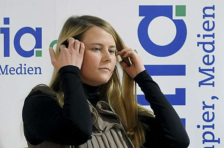 "Natascha Kampusch, during the presentation of her book ""3,096 Tage"" (3,096 Days) at a book store in Vienna, Austria, on Thursday, Sept. 9, 2010. Kampusch, who was kidnapped at age 10 says she was repeatedly beaten, starved and forced to do housework half-naked during her 8 1/2 years at the mercy of a man who admired Hitler and considered himself an Egyptian god. Photo: Helmut Fohringer, AP"