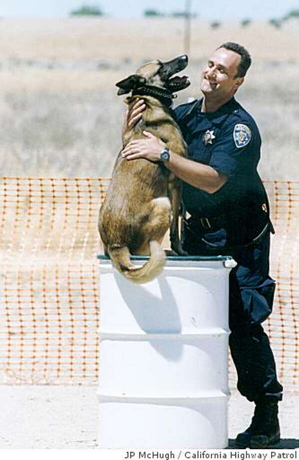 Frank Romano and Rexx upon completion of their first trial of of the agility course portion, which Rexx took 1st place. Photo: JP McHugh, California Highway Patrol