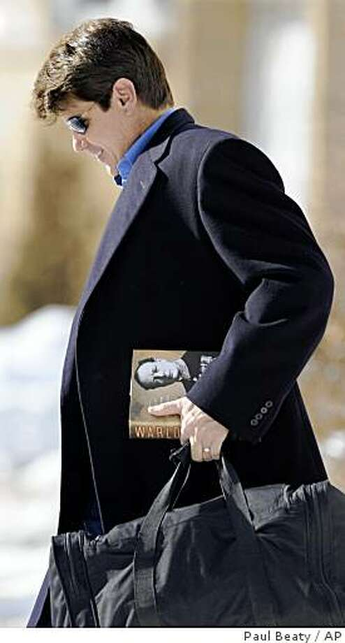 Illinois Gov. Rod Blagojevich leaves his home in Chicago, Sunday, Jan. 25, 2009, carrying a biography of Winston Churchill before flying to New York to appear on national television shows. (AP Photo/Paul Beaty) Photo: Paul Beaty, AP