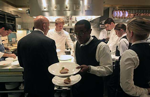 French Laundry waiters and food runners line up in front of Chef de Cuisine, Timothy Hollingsworth who is plating up one of the thirteen courses offered on the nightly dinner serving. For many this is an once-in-a-lifetime dining experience at this three Michelin star restaurant in Yountville Ca. Saturday August 21, 2010. Photo: Lance Iversen, The Chronicle