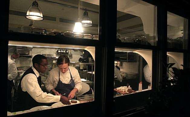 Food Runner Chris Gaither and De Partie Chef Adina Guest team up to plate one of thirteen-courses served Saturday August 21, 2010 at the French Laundry restaurant in Yountville Ca. Photo: Lance Iversen, The Chronicle