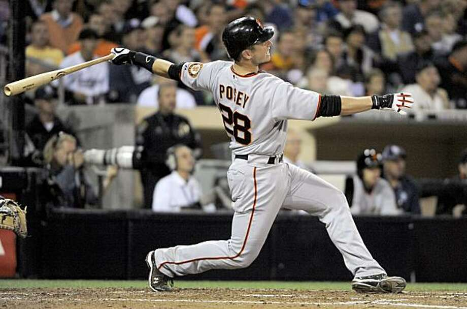 San Francisco Giants' Buster Posey, watches his two-run home run against the San Diego Padres during the fifth inning of a baseball game in San Diego, Thursday, Sept. 9, 2010. Photo: Chris Carlson, AP
