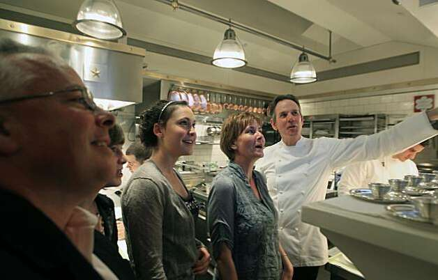 French Laundry Executive Chef Thomas Keller right gives The Miller family from Walnut Creek a tour of the kitchen as they celebrated their daughters 17th birthday. Tim Miller left, daughters Allie and 13, Kate 17, and mother Debby. The staff works long hours creating for many a once-in-a-lifetime dining experience at this three Michelin star restaurant in Yountville Ca. Saturday August 21, 2010 . Photo: Lance Iversen, The Chronicle