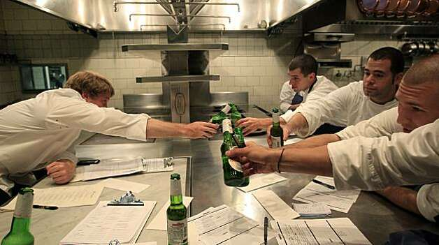 French Laundry Chef de Cuisine, Timothy Hollingsworth left reaches out to clink bottles with his team of chefs after they changed the menu which they do nightly at the 3-Michelin star restaurant in Yountville Ca. Saturday August 21, 2010. Photo: Lance Iversen, The Chronicle