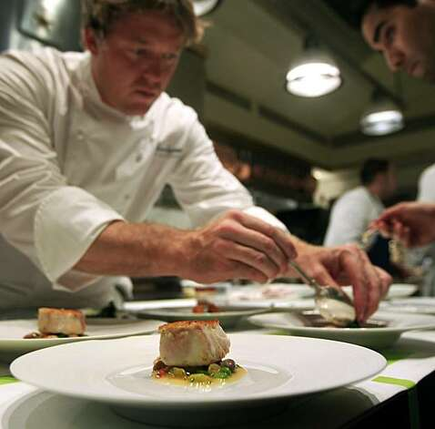 French Laundry Chef de Cuisine, Timothy Hollingsworth plates up one of the thirteen courses offered on the nightly dinner serving, an order of Atlantic Striped Bass served with Tomales Bay Clams, Summer Pole Beans and Whole Grain Mustard. Saturday August 21, 2010. Photo: Lance Iversen, The Chronicle