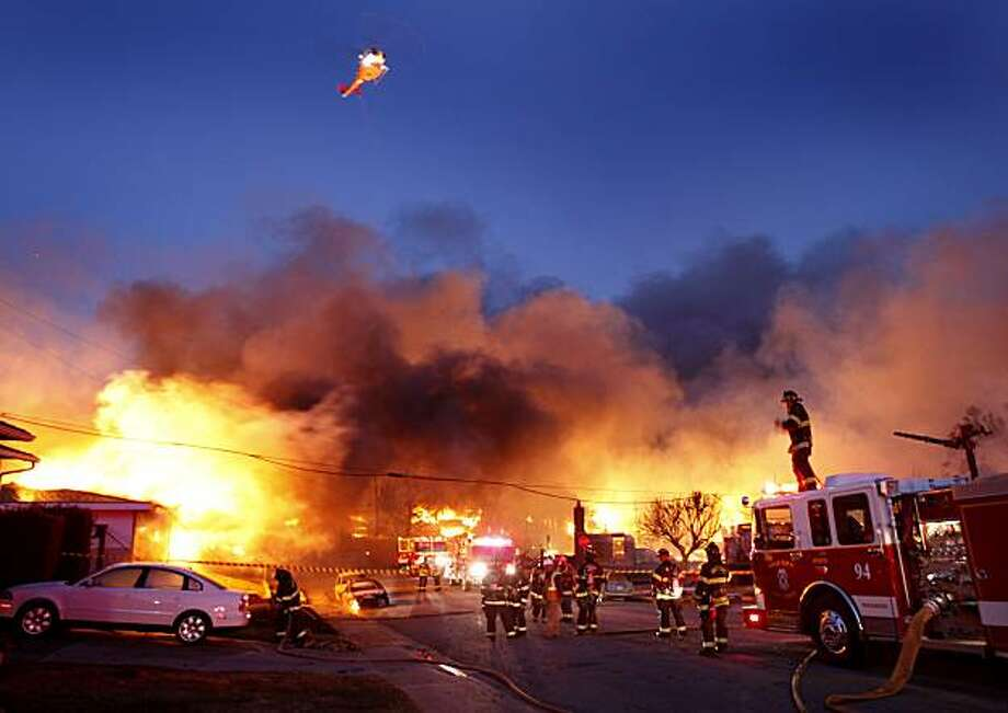 A CDF helicopter hovered above fire fighting efforts on the west side of the fire in San Bruno. A blast believed to be caused by a natural gas explosion destroyed a San Bruno, Calif. neighborhood Thursday September 9, 2010. Photo: Brant Ward, The Chronicle
