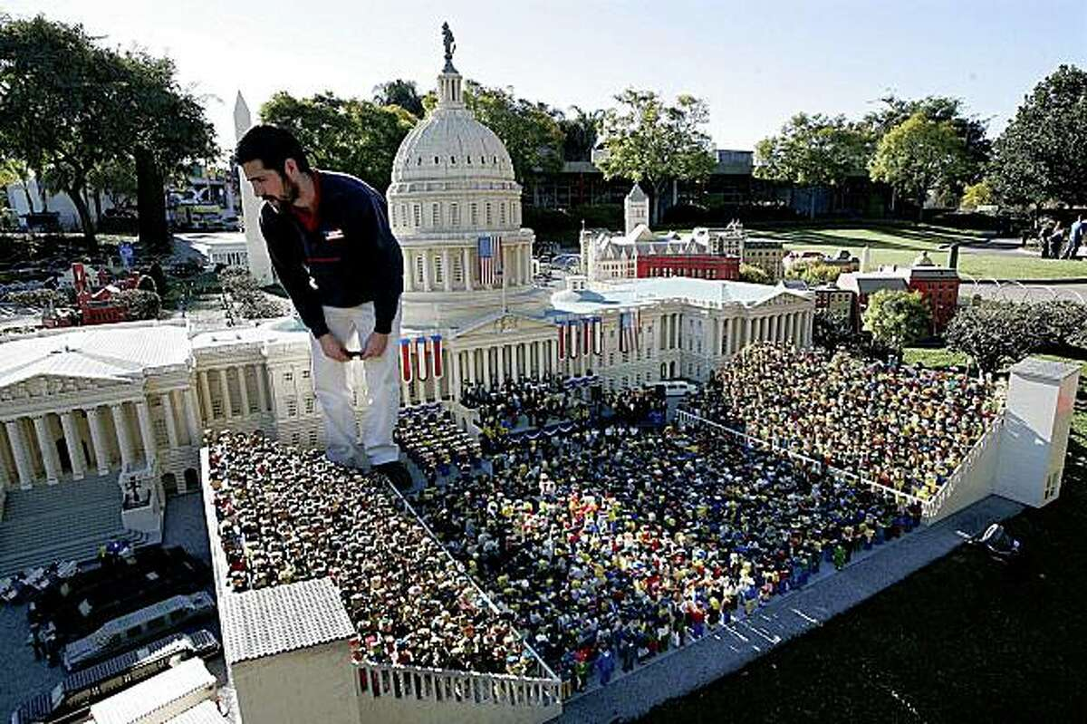 This image provided by Legoland California shows a Legoland employee putting finishing touches on a Lego replica of President Barack Obama's presidential inauguration, on display at Legoland California on Thursday, Jan. 15, 2009 in Carlsbad, Calif. (AP Photo/Legoland, Sandy Huffaker) ** NO SALES **