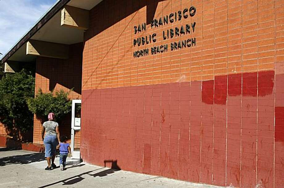 People walk past the North Beach Branch San Francisco Library,  Thursday Sept. 10, 2009, in San Francisco, Calif. The library is slated for demolition, but some folks want it to become a landmark instead. Photo: Lacy Atkins, The Chronicle