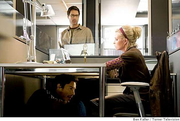 "Eric McCormack,  Monica Potter, and Tom Cavanagh (under table) in TNT's ""Trust Me."" Photo: Ben Kaller, Turner Television"