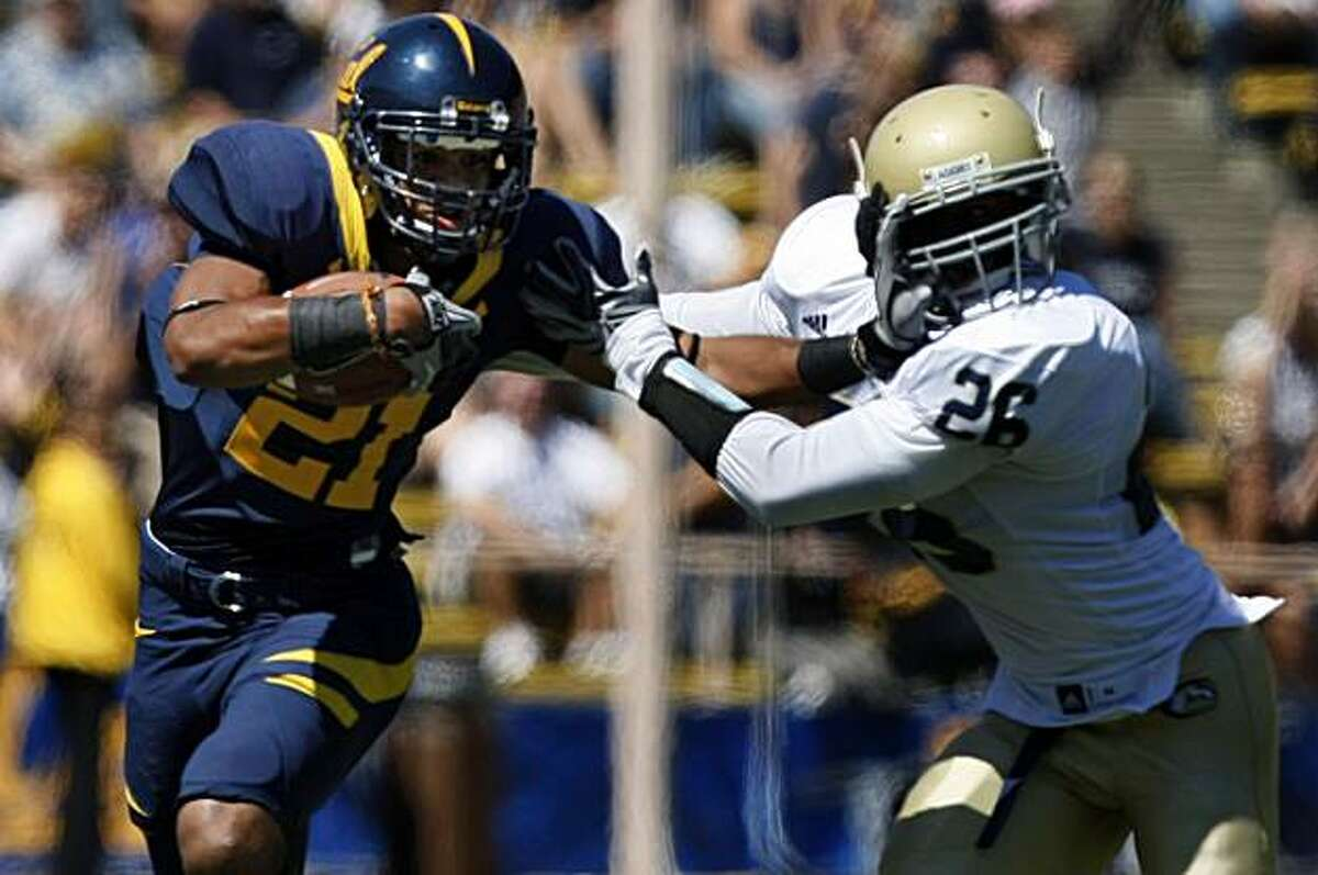 Cal's Keenan Allen straight arms UC Davis' Kevyn Lewis after Allen hauled in a Kevin Riley pass that took the Bears deep into Aggie territory in the first half in Berkeley on Saturday.