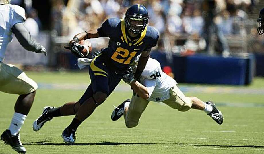Cal's Keenan Allen (21) breaks a tackle for a first down in first half against UC Davis in Berkeley on Saturday. Photo: Lance Iversen, The Chronicle