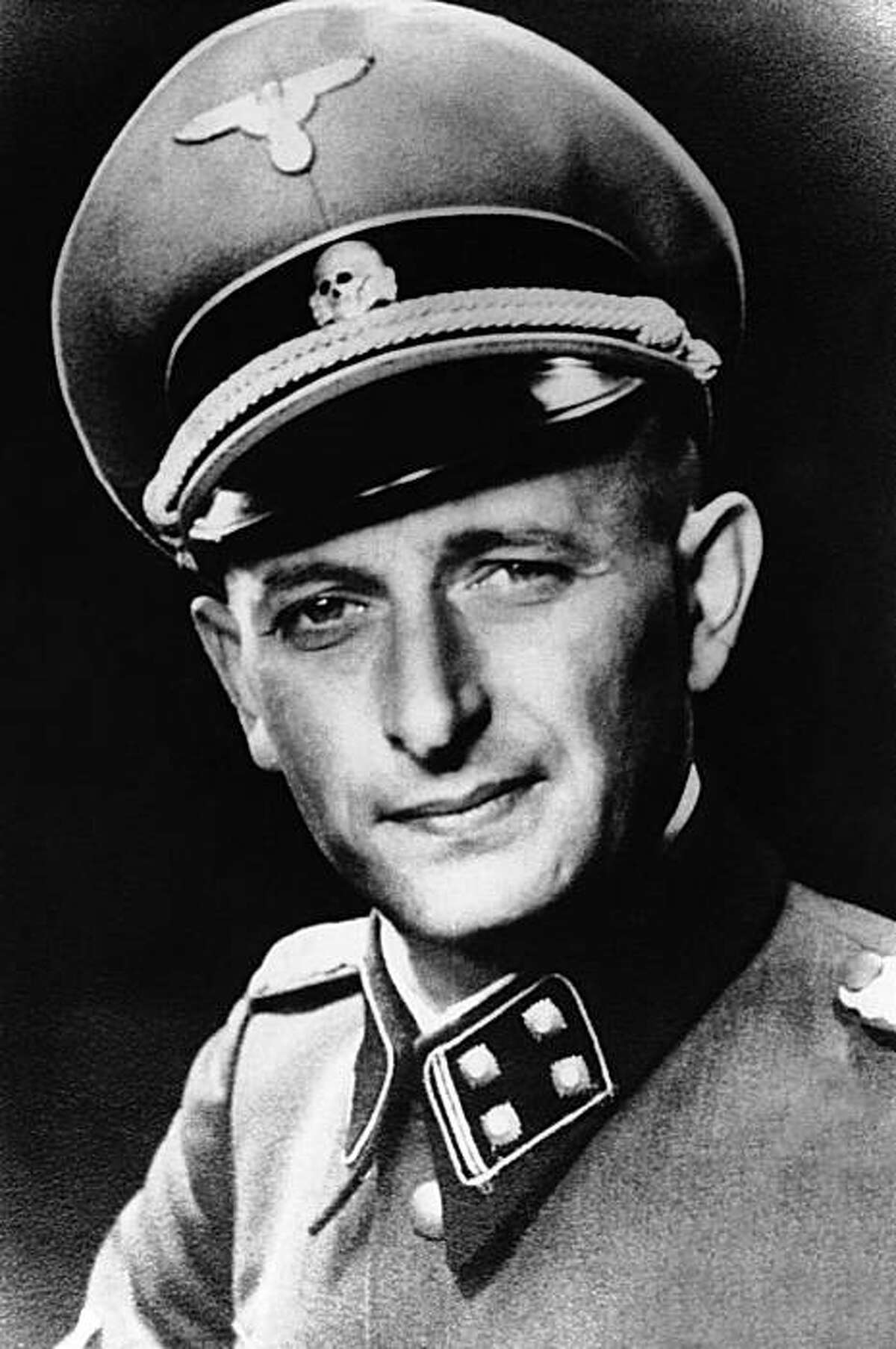 In this undated file picture Adolf Eichmann at the height of his power as the Nazi SS Lieutenant Colonel in charge of Hitler's Jewish bureau is photographed at unknown location. Germany's intelligence service has turned over thousands of files on Adolf Eichmann's whereabouts after World War II to a journalist who sued for them - but with so many passages blacked out and pages missing that she's taking the matter back to court. When freelance reporter Gabriele Weber went to see the files on the man known as the