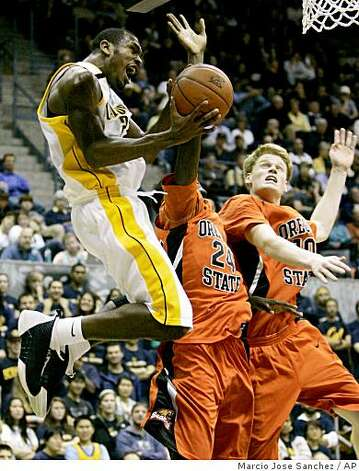 California's Patrick Christopher, left, tries to shoot past Oregon State's Omari Johnson, center, and Roeland Schaftenaar in the second half of an NCAA college basketball game in Berkeley, Calif., Thursday, Jan. 22, 2009. Oregon State won 69-65. (AP Photo/Marcio Jose Sanchez) Photo: Marcio Jose Sanchez, AP