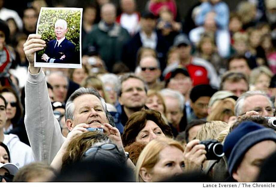 """A man holds up a photo of US Airways Captain Chesley """"Sully"""" Sullenberger III as he and several thousand gathered in front of the Danville Library Saturday, Jan 24, 2009 to honor the hero of the Hudson. Photo: Lance Iversen, The Chronicle"""