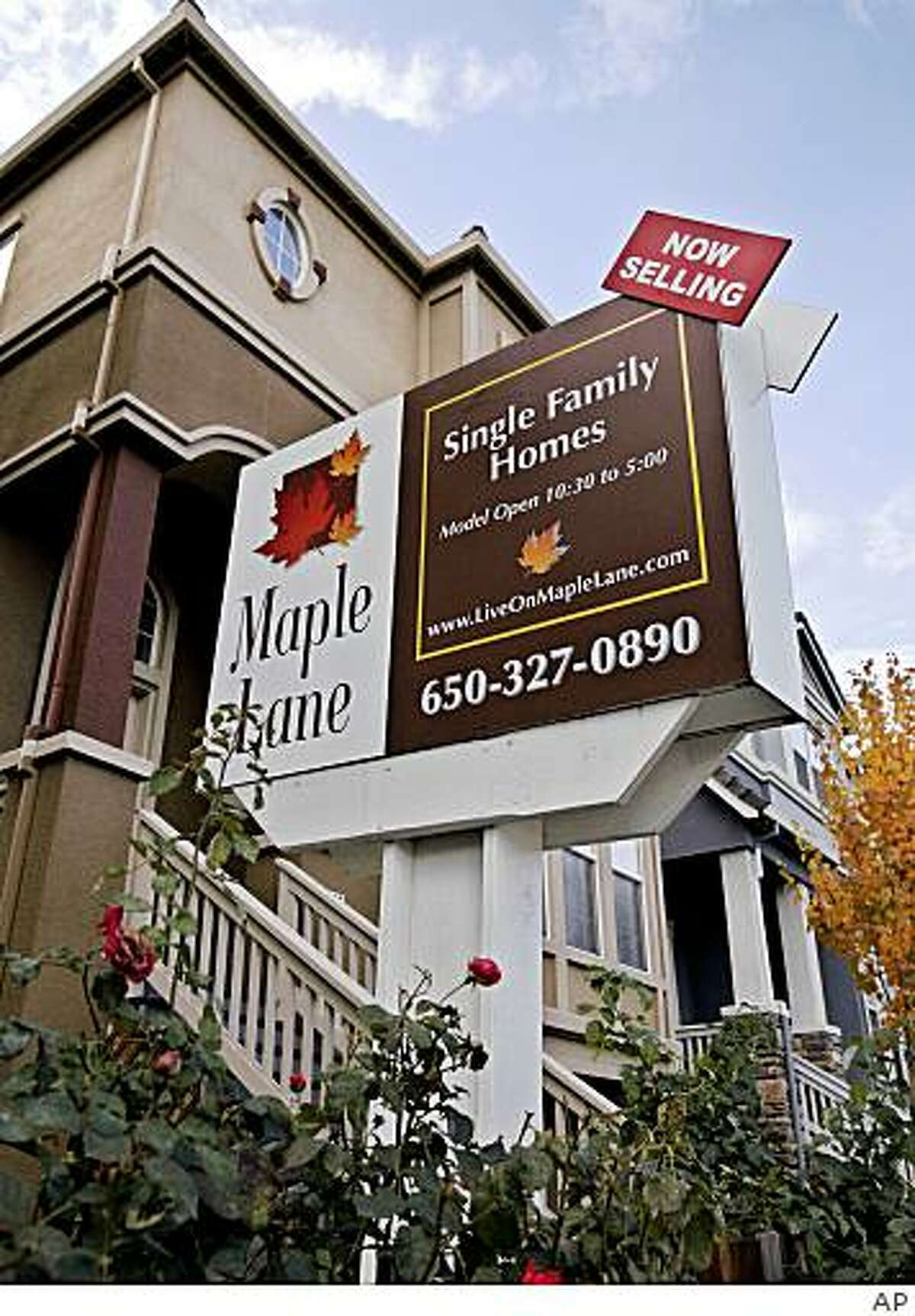 A new home is shown in East Palo Alto. A real estate tracking firm says the median home prices in the Bay Area fell nearly 44 percent in December 2008 from a year earlier as more bargain hunters scooped up foreclosure properties.